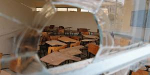 Chairs are seen through a broken window at the Garissa University College in Garissa