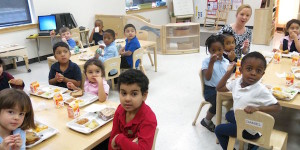 PreK students sitting in classroom looking at camera