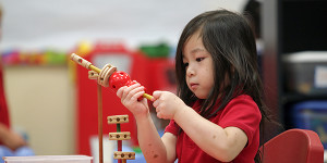 Pre-k student Jenny Dang, 4, plays with tinker toys Thursday morning at Sherman Avenue Elementary.
