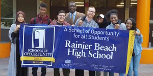Rainer Beach students holding up school sign