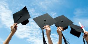 graduation hats and diploma