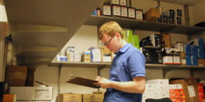 student with disability working in stock room