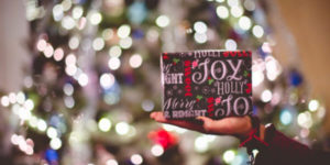 Gift in front of a blurry Christmas tree