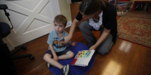 child with autism receiving ABA therapy
