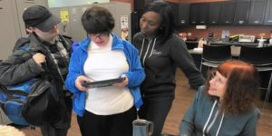 group of students looking at a tablet