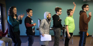 group of teens with ASD at improv class