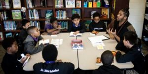 group of fifth graders at a book club with teacher