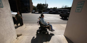 young person in an electronic wheelchair