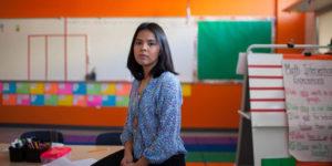 hispanic or latina young teacher in classroom daca