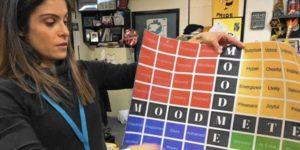 teacher holding up a mood meter