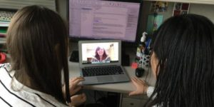 mom and daughter on Skype talking to therapist