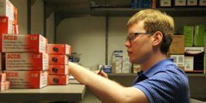 young man working in stock room