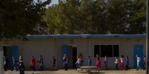 students walking outside of a school