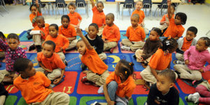group of preK students wearing orange shirts except for one
