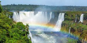 rainbow across a waterfall