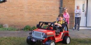 power toy car with happy boy